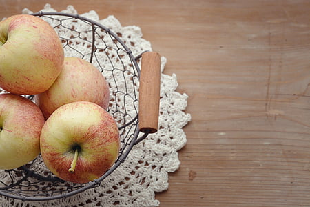 apples on gray basket
