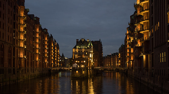 low-angle photography of buildings near body of water
