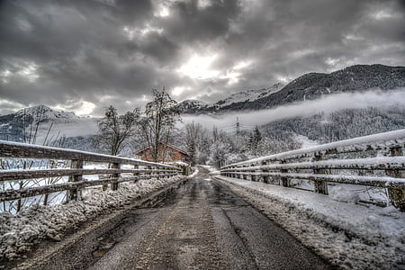 winding road with snow photo