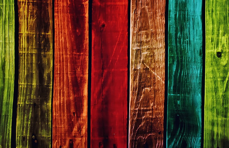 red, blue, and lime-green wooden fence