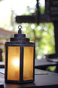 selective focus photography of gray and brown tubular lantern