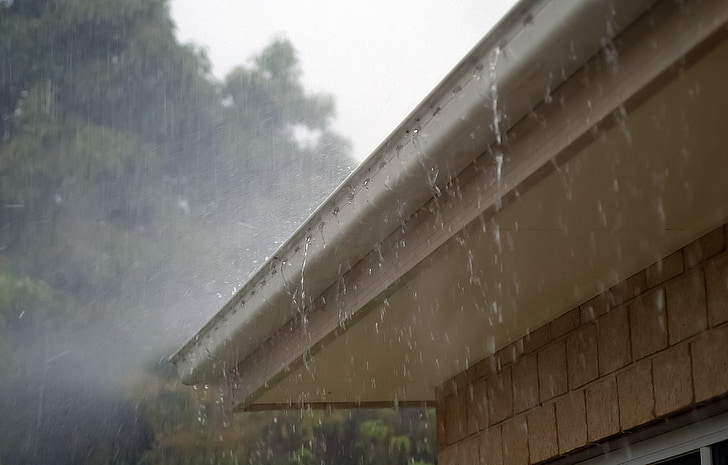 Royalty-Free photo: Rainwater dripping on house roofs | PickPik