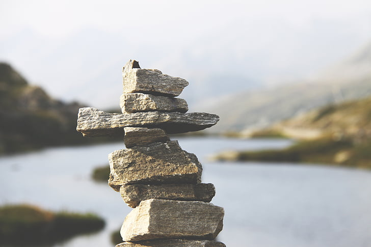 selective focus photo of stacked rocks at daytime