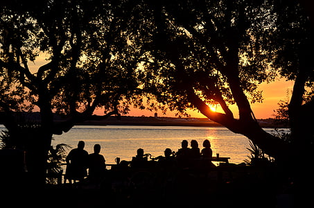 silhouette photography of people during sunset