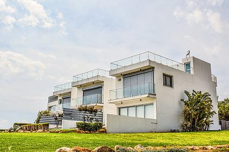 white and gray concrete house