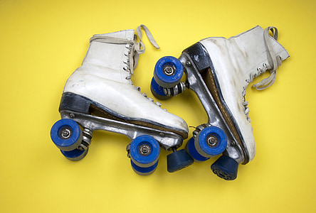 pair of white leather roller skates