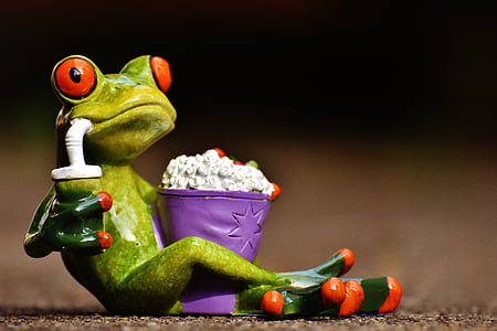 frog sipping juice with popcorn ceramic figurine