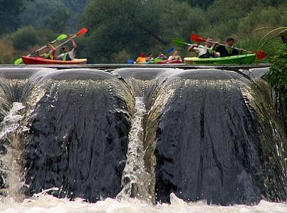 people riding on kayak in river