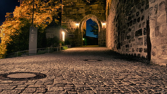 bricked road during nighttime