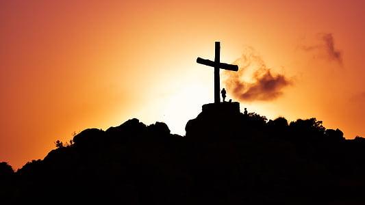 silhouette photo of cross on mountain