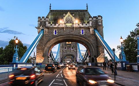 vehicles passing under Tower Bridge London