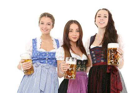 three women wearing dresses standing while folding glass tankards filled with beers