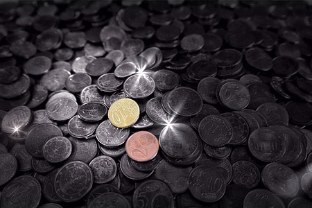 selective focus photography of assorted-denomination Indian coins