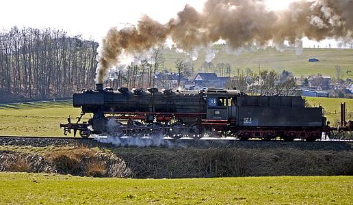 black steel train on black steel rail