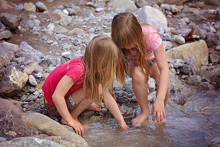 two girls playing on water