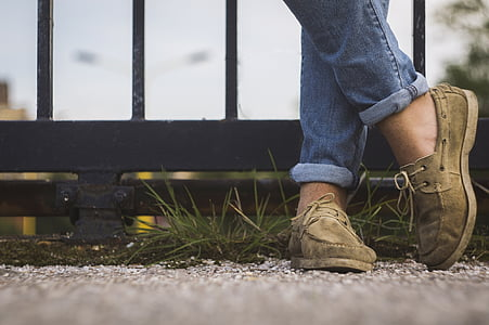 man wearing brown suede boat shoes