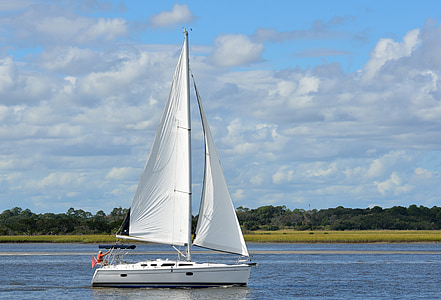 boat sailing on body of water during daytime