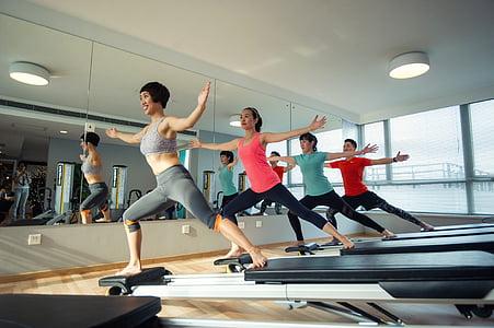 women doing exercise inside room