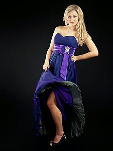 woman in blue sweetheart neckline strapless dress