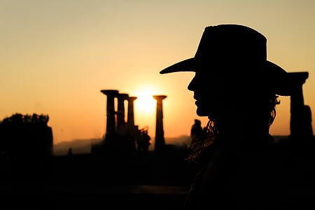 silhouette photography of person wearing cowboy hat