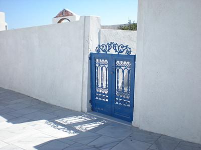 blue steel gate during daytime