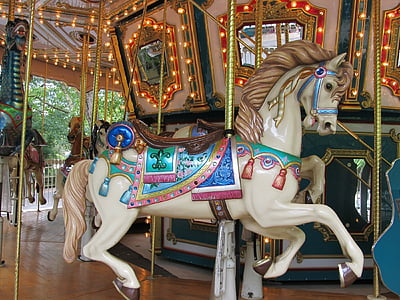 white, blue, and brown horse carousel