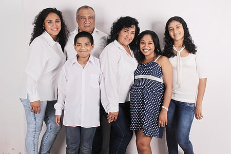 group of people smiling for a photo against white background