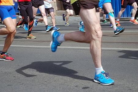 pair of blue Nike Free Rune running shoes