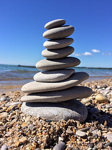 gray stacking stones near body of water