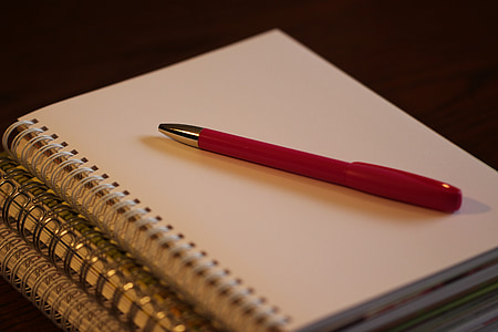 red click pen on white notebook