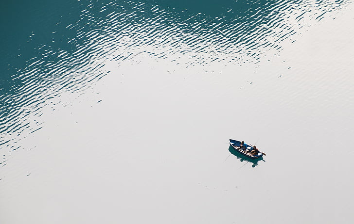 aerial photo of persons on rowboat during daytime