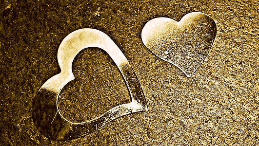 two heart glass decor on brown surface