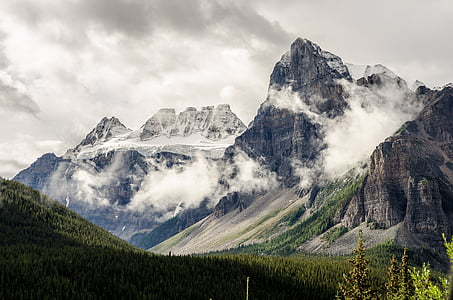 photo pf grey rock mountains nearby trees