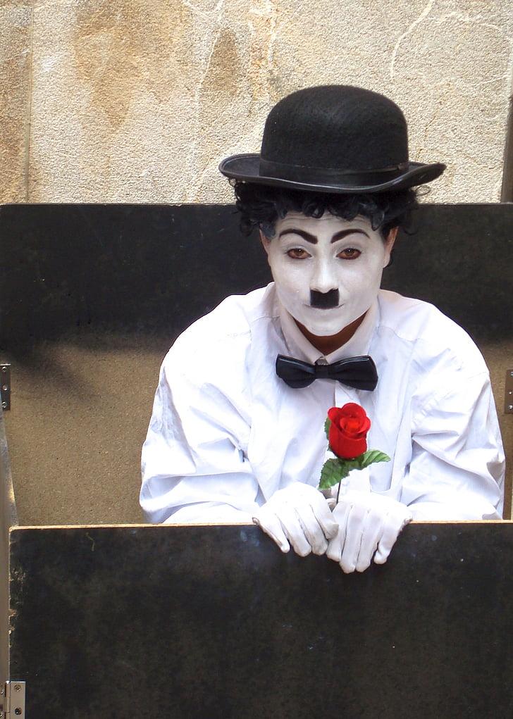 man in white dress shirt and Charlie Chaplin makeup