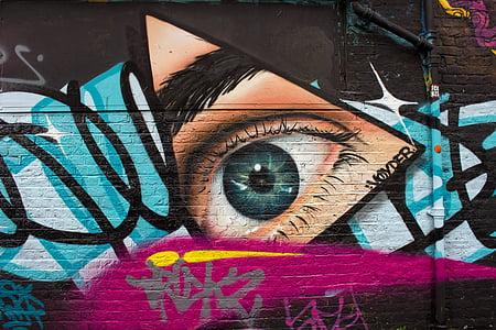 graffiti with wall arts at daytime