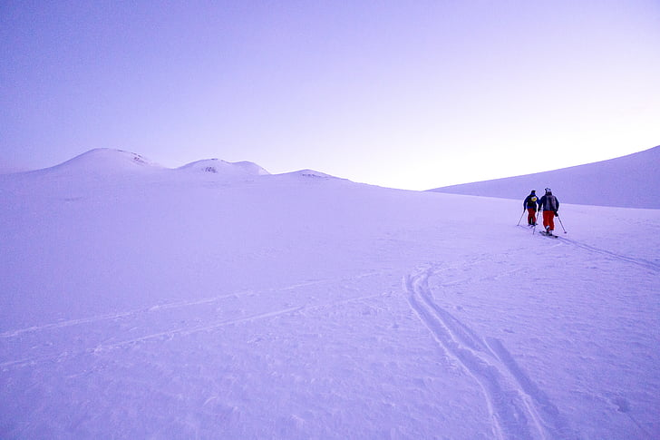 two persons on snow