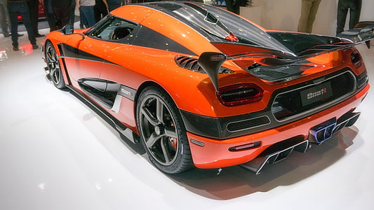 orange and black sports coupe inside room