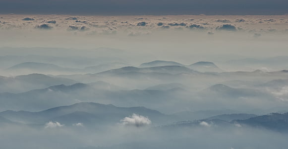aerial photography of mountain range with fogs