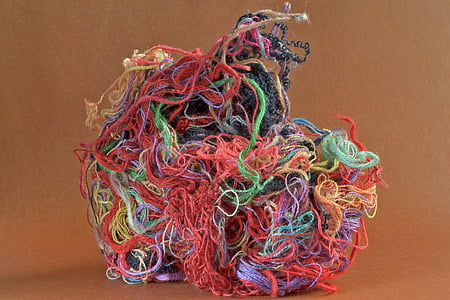 assorted-color threads on brown surface