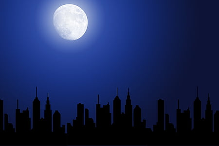 moon shining over city buildings