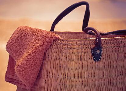 macro shot of brown towel on brown wicker bag
