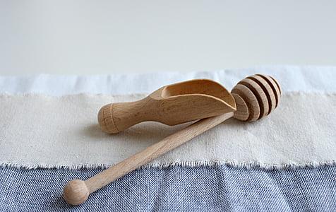 brown wooden honey comb and honey scoop