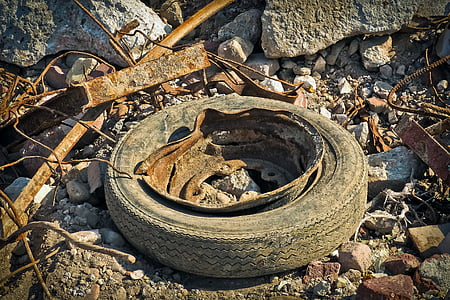 rusted vehicle wheel with tire