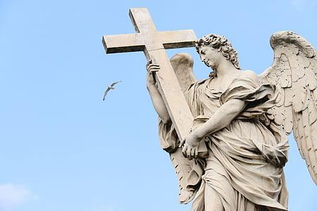 woman angel holding cross statue