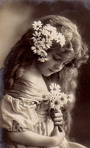 grayscale photography of girl holding flowers