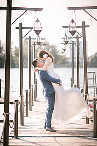wedding couple standing on dock