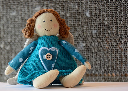 teal knitted doll