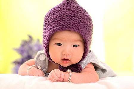 baby wearing purple knitted chulo and gray top