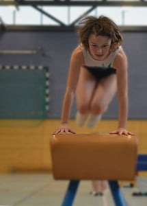 selective focus photo of woman doing gymnast