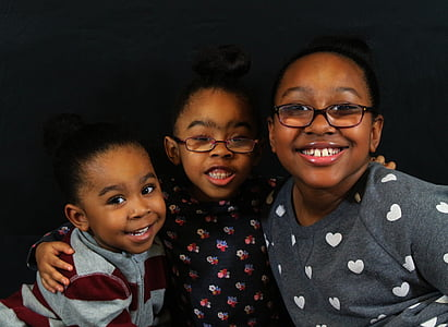 three children's taking group pictures